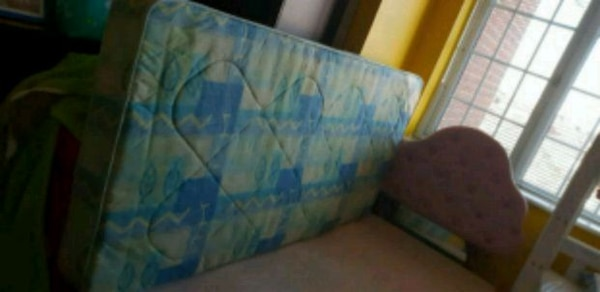 blue and white bed sheet