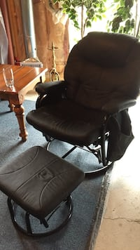 black steel frame padded armchair with ottoman