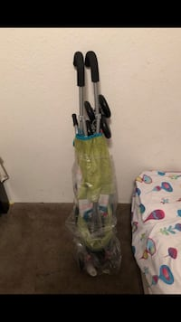 green and black upright vacuum cleaner Houston, 77087