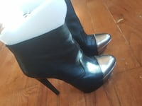 pair of black leather heeled booties Falls Church, 22046