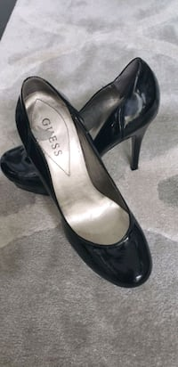 pair of black leather pumps Toronto, M8Z 4R9
