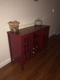 Red wooden console with glass cabinet storage and center shelving  Ashburn, 20148
