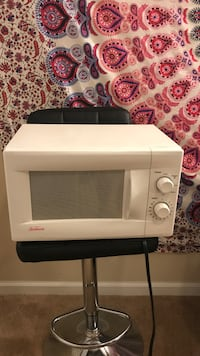 White and gray microwave oven Greensboro, 27407