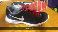 pair of black-and-red Nike running shoes Surrey, V3R 3S9