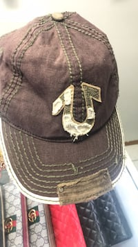 Brown and white fitted cap
