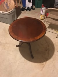 round brown wooden pedestal table. Herndon, 20171