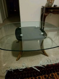 round glass-top table with black steel base Alexandria, 22311