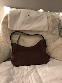 Vintage and authentic Kate Spade small purse. 9x6 with paten leather strap, brown leather. Comes with original bag.  Germantown, 20874