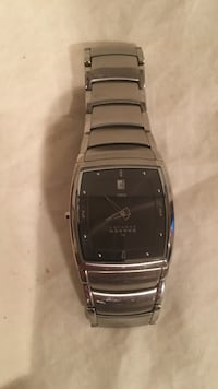 This is a skagen Denmark steel New watch no tags scratches and wristband and it needs a battery but other than that it's a new watch Port Jefferson Station, 11776