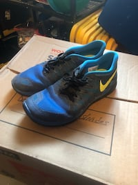Pair of blue nike running shoes with box 48 mi