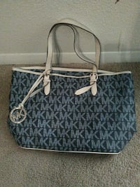 gray and black Michael Kors leather tote bag