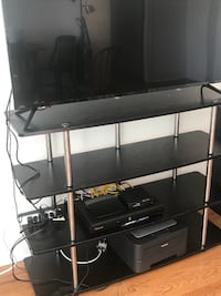 black and gray TV stand null