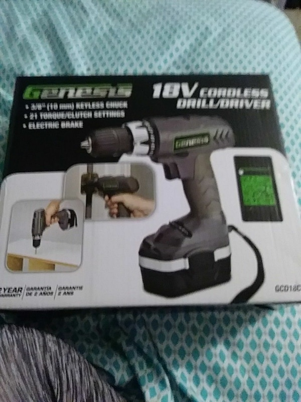gray and black Genesis cordless drill/driver box