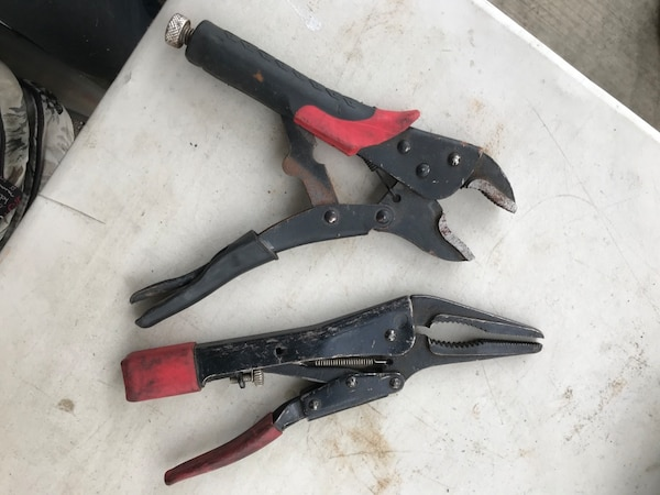 two black and red hand tools