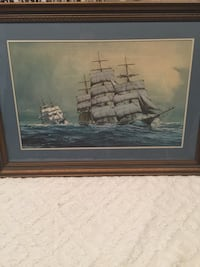 galleon boat painting with brown wooden frame