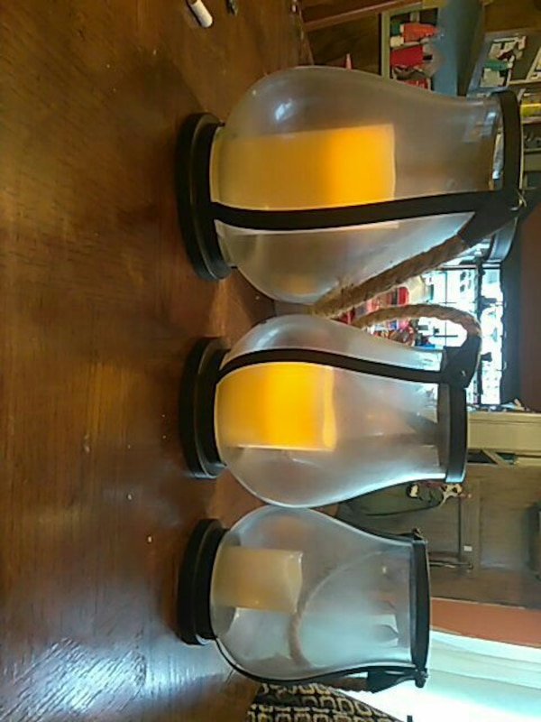 three clear candle holder set
