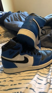 blue-and-white Nike Air Force 1 mid-rise shoes