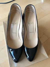 Pair of black leather Louboutin heels Edmonton
