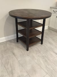Kitchenette dining table.  Dark stained solid wood. Jacksonville, 32258
