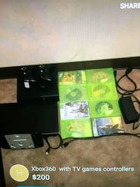 black Xbox One console with game cases Regina, S4N 0T9
