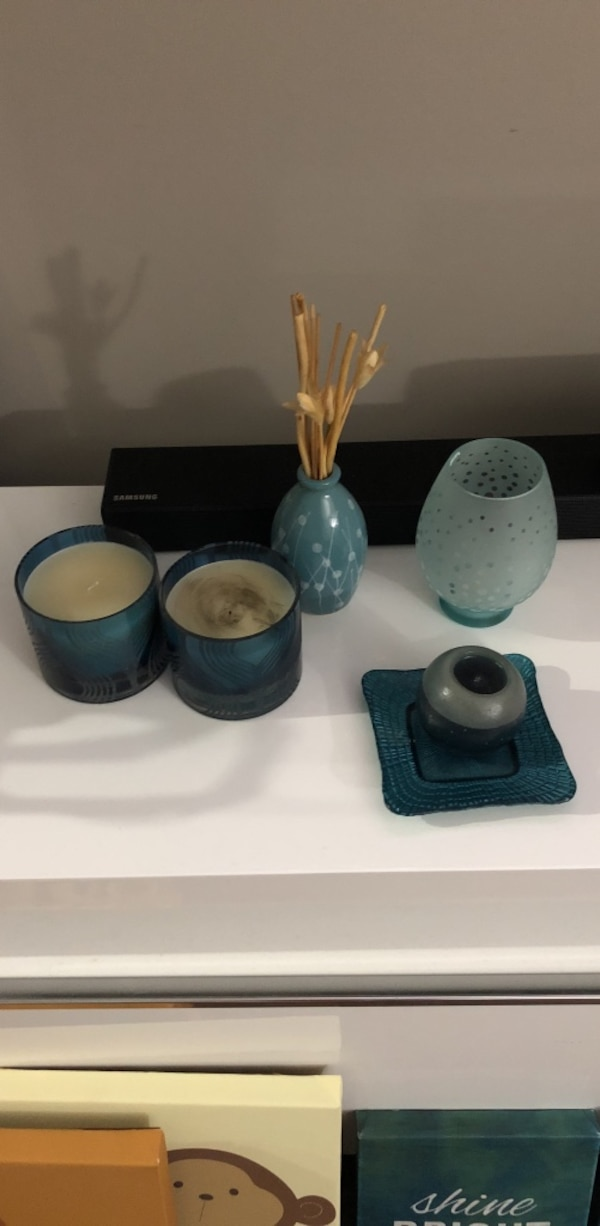 two blue votive candles