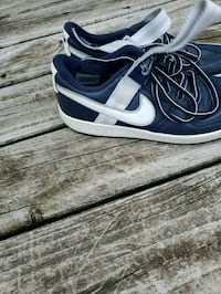 pair of black-and-white Nike sneakers Kentwood