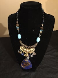 New handcrafted sea sediment pendant necklace w amethyst, tiger eye and various dead beads . Magnet  clasp 417 mi