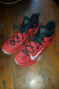 Size 13 pair of red Nike basketball shoes 231 km
