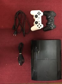 Black sony ps3 super slim console with two controllers Toronto, M1K 3B6