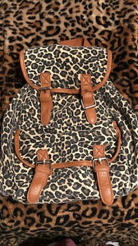brown, black, and gray leopard-print back pack Richland, 15904