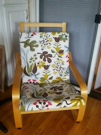 white, green, and red floral padded armchair