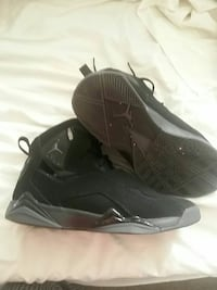 pair of black Air Jordan 7 basketball shoes Des Moines, 50316
