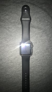 stainless steel Apple watch with black sports band