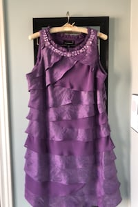 Evening dress is purple court size 14 .
