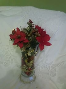red and green artificial flowers centerpiece