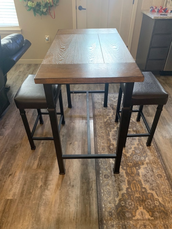 Bistro table and stools a91396c3-1f97-4717-af20-d08734fc4f2a