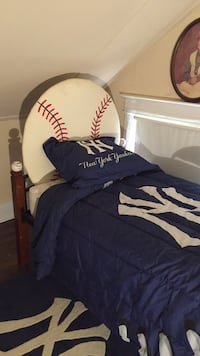 Baseball bed one of a kind built by a GE engineer has baseball for headrest and baseballs in all 4 posts comes with Yankee pillow cases Yankee comforter  Yankee throw rug mattress and box springs it's never been used