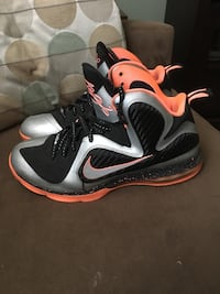 pair of black-and-white Nike basketball shoes New York, 11416
