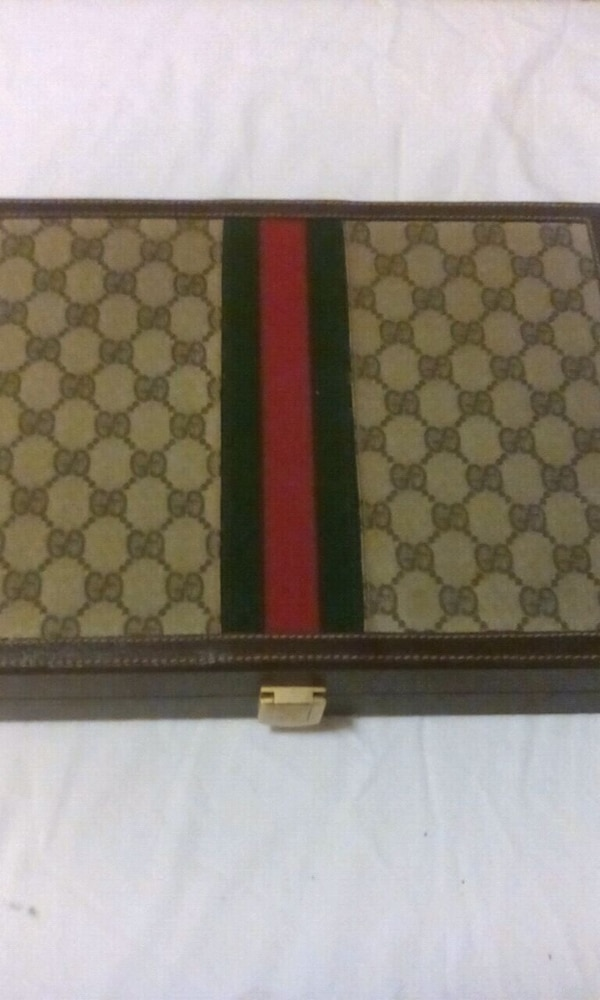brown and black Gucci leather wallet
