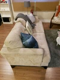 Suede comfy couch. It can hold 5 people.