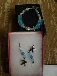 pair of silver-and-blue stud earrings