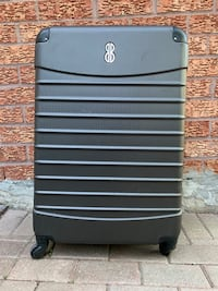 *** URGENT Luggage Valise Hard Shell Grey Four wheeler and missing one Great use if you can have it fixed! Toronto, M1E 5B8