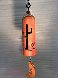 orange and black metal wind chime