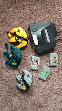 black Nintendo 64 console with controllers and game cartridges Portland, 97201