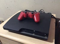 Black sony ps3 slim console with red controller Winnipeg, R2X 0R1