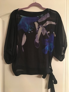 black, white, and blue floral scoop neck long sleeved shirt