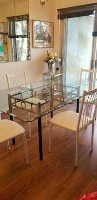 Beveled glass table plus four chairs. Moving Sale  Montreal