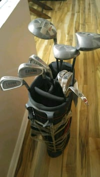black and gray golf bag with golf clubs Windsor, N8T 2X7