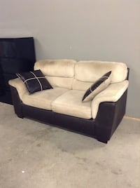 White and black fabric sofa at the HFH ReStore  Hamilton, L8H 7P4
