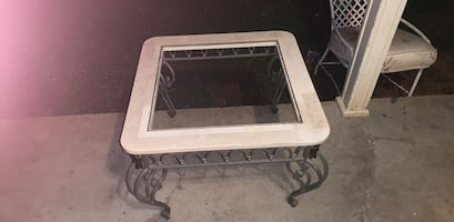 Marble and rod iron coffee table. Heavily constructed and durable,